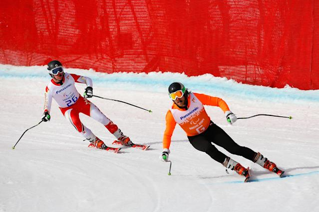 SOCHI, RUSSIA - MARCH 08: Mac Marcoux of Canada and guide Robin Femy compete in the Men's Downhill - Visually Impaired during day one of Sochi 2014 Paralympic Winter Games at Rosa Khutor Alpine Center on March 8, 2014 in Sochi, Russia. (Photo by Tom Pennington/Getty Images)