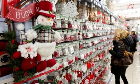 FILE PHOTO: A woman looks at Christmas decorations in a shop in Rome