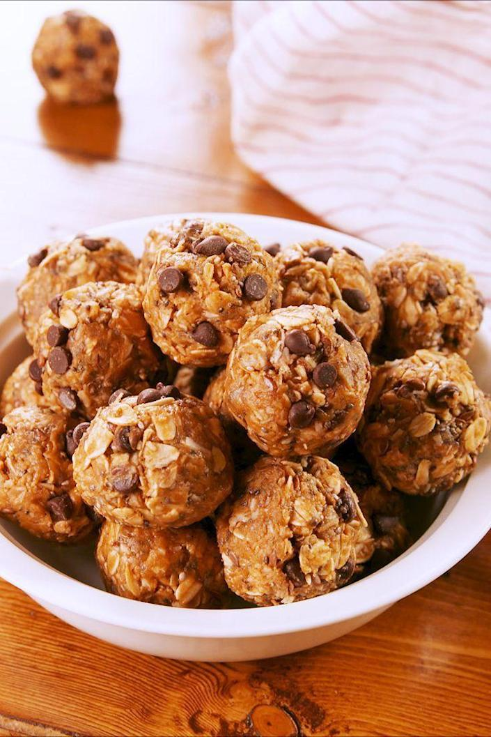 """<p>When you need a little energy boost, these peanut butter bits will give you new life. </p><p>Get the recipe from <a href=""""https://www.delish.com/cooking/recipe-ideas/a25416301/protein-balls-recipe/"""" rel=""""nofollow noopener"""" target=""""_blank"""" data-ylk=""""slk:Delish"""" class=""""link rapid-noclick-resp"""">Delish</a>. </p>"""