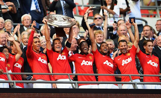 LONDON, ENGLAND - AUGUST 11: Nemanja Vidic of Manchester United lifts the trophy and celebrates with team mates after victory in the FA Community Shield match between Manchester United and Wigan Athletic at Wembley Stadium on August 11, 2013 in London, England. (Photo by Laurence Griffiths/Getty Images)