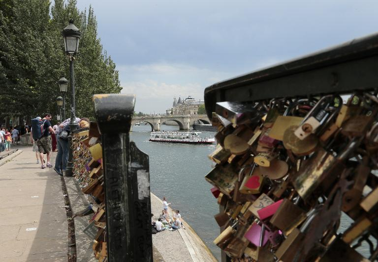 Barriers loaded with padlocks are pictured on the Pont des Arts in Paris on June 9, 2014