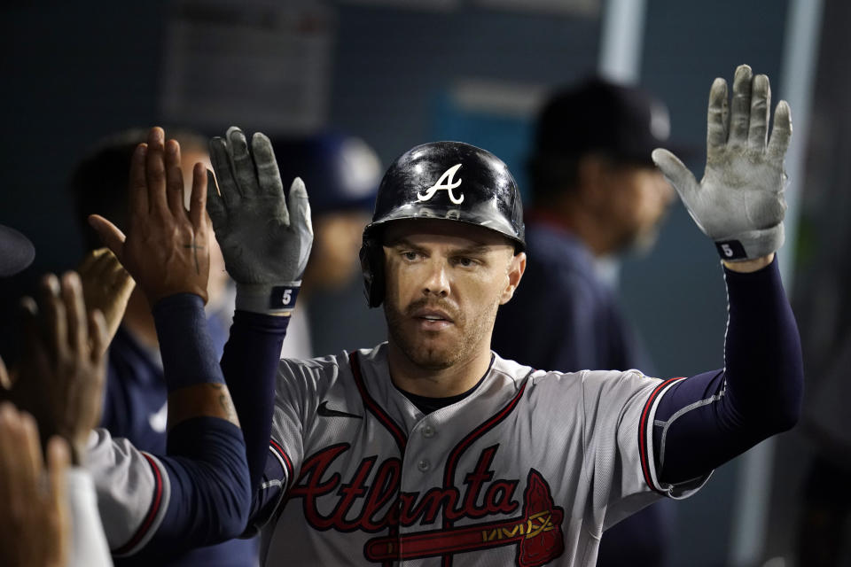 Atlanta Braves' Freddie Freeman celebrates his solo home run in the dugout during the sixth inning of a baseball game against the Los Angeles Dodgers Monday, Aug. 30, 2021, in Los Angeles. (AP Photo/Marcio Jose Sanchez)