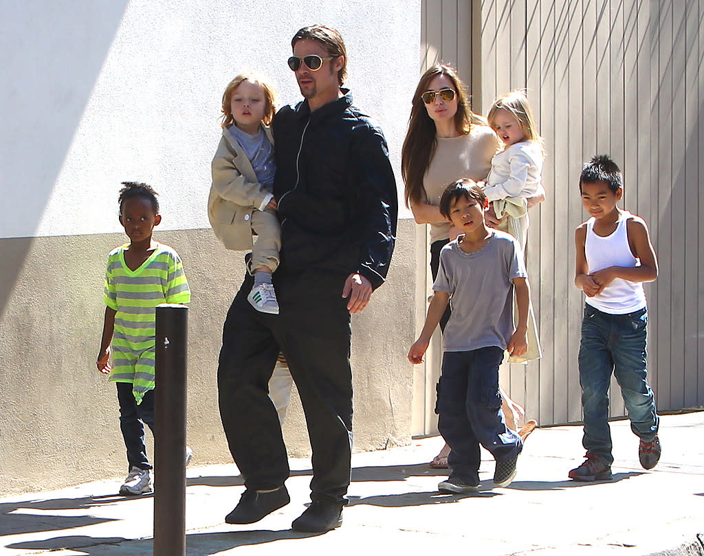 "While married to Jennifer Aniston, Brad Pitt talked openly about his dream of becoming a father, but it wasn't until he got together with then-mom-of-one Angelina Jolie in early 2005 that he made it a reality – and now they have six kids! The ""Salt"" actress already had adopted son Maddox, now 11, when she met Pitt on the set of ""Mr. and Mrs. Smith."" Shortly after, in July 2005, she adopted daughter Zahara, now 7, with Pitt by her side. Less than a year later, Jolie and Pitt welcomed their first biological child, Shiloh, now 6. As if the Jolie-Pitt household wasn't crazy enough, the couple adopted three-year-old Pax, now 8, in March 2007, and then in July 2008, they welcomed two more biological kids, twins Knox and Vivienne. Jolie and Pitt have yet to say if they will have any more children. Can you blame them?"