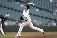 Seattle Mariners starting pitcher Chris Flexen works against the Colorado Rockies during the first inning of a baseball game, Tuesday, June 22, 2021, in Seattle. (AP Photo/John Froschauer)