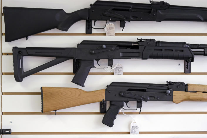 FILE - In this Oct. 2, 2018, file photo, semi-automatic rifles are displayed on a wall at a gun shop in Lynnwood, Wash. Lawmakers in Oregon are considering a proposed gun storage law that would be the among strongest in America (AP Photo/Elaine Thompson, File)