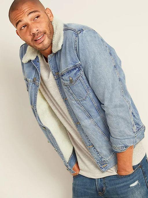 """This Sherpa-Lined Medium-Wash Jean Jacket for Men is available in sizes XS to XL. <a href=""""https://fave.co/3ki8e3z"""" target=""""_blank"""" rel=""""noopener noreferrer"""">Get it on sale for 50% off (normally $75) at Old Navy</a>."""