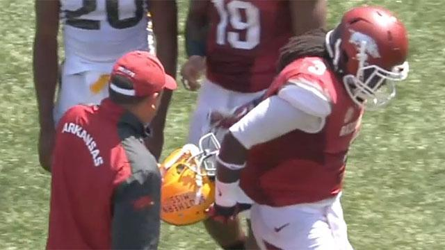 Southern Miss player's facemask had to be removed from Arkansas player's jersey (GIF)