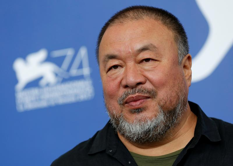 "Ai Weiwei poses during a photo call for his documentary, ""Human Flow,"" at the Venice Film Festival. Sept. 1. (Alessandro Bianchi / Reuters)"