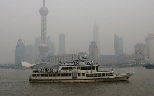 A boat cruise pass the Pudong financial area, which is shrouded by heavy pollution in Shanghai. Most Chinese cities currently base their air-quality information on particles of 10 micrometres or larger and do not take into account finer particulates that experts say are most harmful to human health