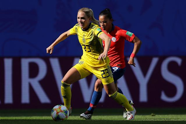 Elin Rubensson of Sweden runs with the ball under pressure from Francisca Lara of Chile during the 2019 FIFA Women's World Cup France group F match between Chile and Sweden at Roazhon Park on June 11, 2019 in Rennes, France. (Photo by Richard Heathcote/Getty Images)