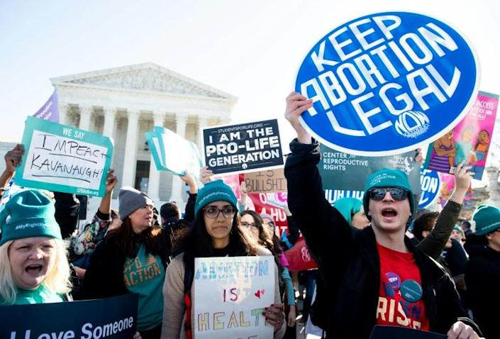 Activists outside the US Supreme Court as it hears what may be the most significant case on abortion in decades (AFP Photo/SAUL LOEB)