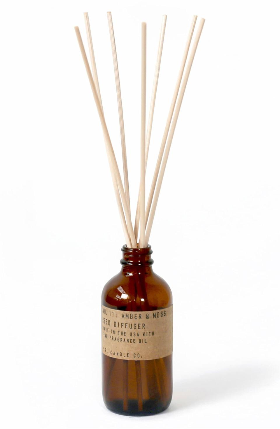 """This amber medicine bottle has an old-school charm, and it comes in a bunch of differently scented reeds (pion, sandalwood rose, or teakwood and tobacco) to suit each of your rooms or moods. $24, Nordstrom. <a href=""""https://shop.nordstrom.com/s/p-f-candle-co-reed-diffuser/5400806?"""" rel=""""nofollow noopener"""" target=""""_blank"""" data-ylk=""""slk:Get it now!"""" class=""""link rapid-noclick-resp"""">Get it now!</a>"""