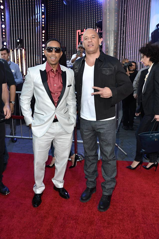 "UNIVERSAL CITY, CA - MAY 21:  Actors Chris 'Ludacris' Bridges and Vin Diesel arrive at the Premiere Of Universal Pictures' ""Fast & Furious 6"" on May 21, 2013 in Universal City, California.  (Photo by Frazer Harrison/Getty Images)"