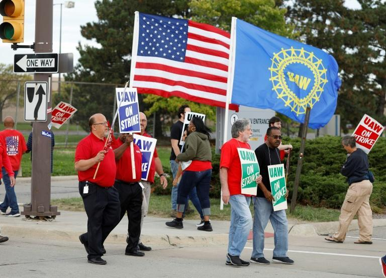 The economic hit from the General Motors strike has grown since the strike began September 16 (AFP Photo/BILL PUGLIANO)