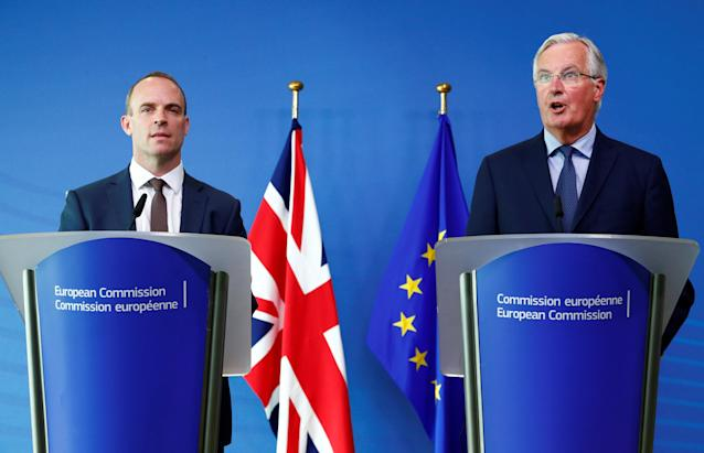 Dominic Raab and Michel Barnier speaking together in Brussels (Getty)