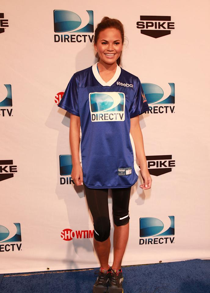 Model Chrissy Teigen arrives at the DirecTV Celebrity Beach Bowl in Indianapolis.