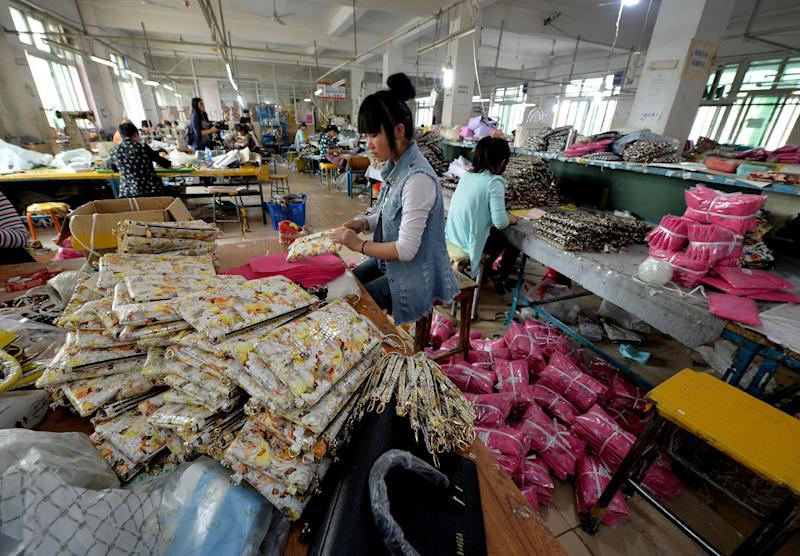 Workers at a handbag factory in Baigou, Hebei Province complete orders to be sold through Taobao (AFP Photo/Mark Ralston)