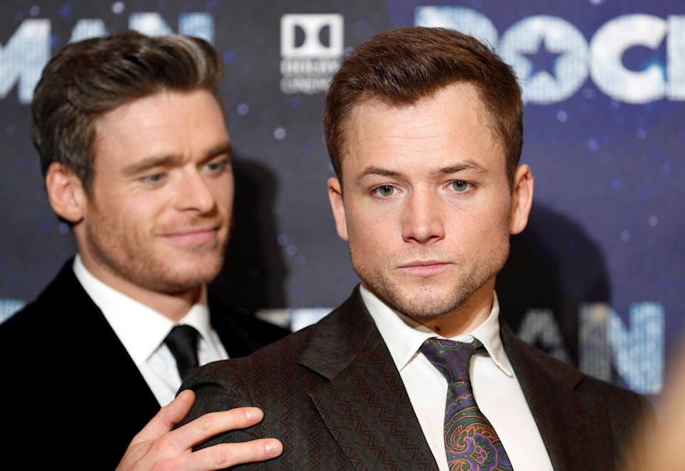 Actors Taron Egerton and Richard Madden, left, arrive for the UK Film Premiere of Rocketman at the Odeon Luxe in London, Monday, May 20, 2019.(AP Photo/Frank Augstein)