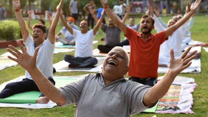 Yoga practitioners exercise ahead of the International Yoga day at a park in Amritsar on June 19, 2021.