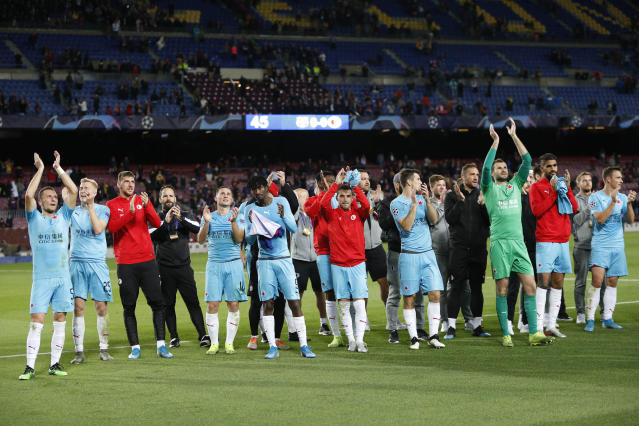 Slavia Praha players celebrate at the end of the Champions League Group F soccer match between Barcelona and Slavia Praha at Camp Nou stadium in Barcelona, Spain, Tuesday, Nov. 5, 2019. Barcelona was held to a 0-0 draw by Slavia Prague in the Champions League group phase on Tuesday. (AP Photo/Joan Monfort)