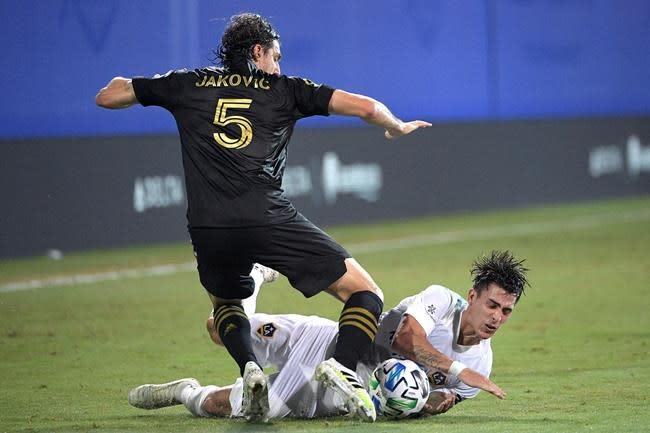 Rossi scores 4 goals to propel LAFC to 6-2 win over Galaxy