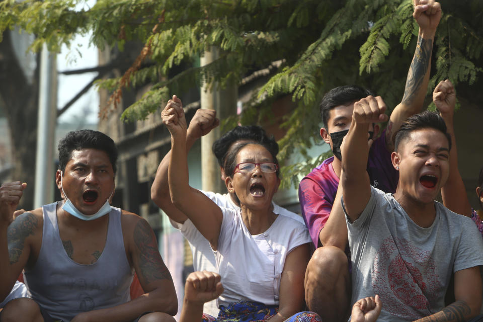 Protesters raise their hands with clenched fists during an anti-coup demonstration in Mandalay, Myanmar, Saturday, March 13, 2021. Myanmar's military seized power Feb. 1, hours before the seating of a new parliament following election results that were seen as a rebuff to the country's generals. (AP Photo)
