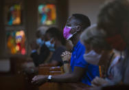 Congregants wear face masks to protect against coronavirus as they attend an Easter Sunday Mass at the Roman Catholic Church in Rosebank, Johannesburg, Sunday March 4, 2021. (AP Photo/Denis Farrell)