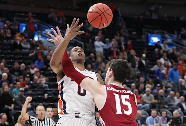 <p>Horace Spencer #0 of the Auburn Tigers battles for the ball with Ivan Aurrecoechea #15 of the New Mexico State Aggies during the first half in the first round of the 2019 NCAA Men's Basketball Tournament at Vivint Smart Home Arena on March 21, 2019 in Salt Lake City, Utah. (Photo by Patrick Smith/Getty Images) </p>