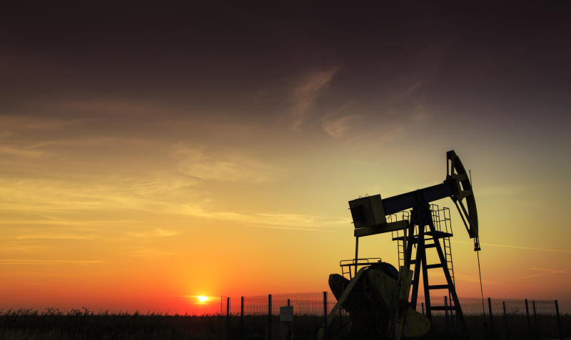 An shale oil pump at sunset.