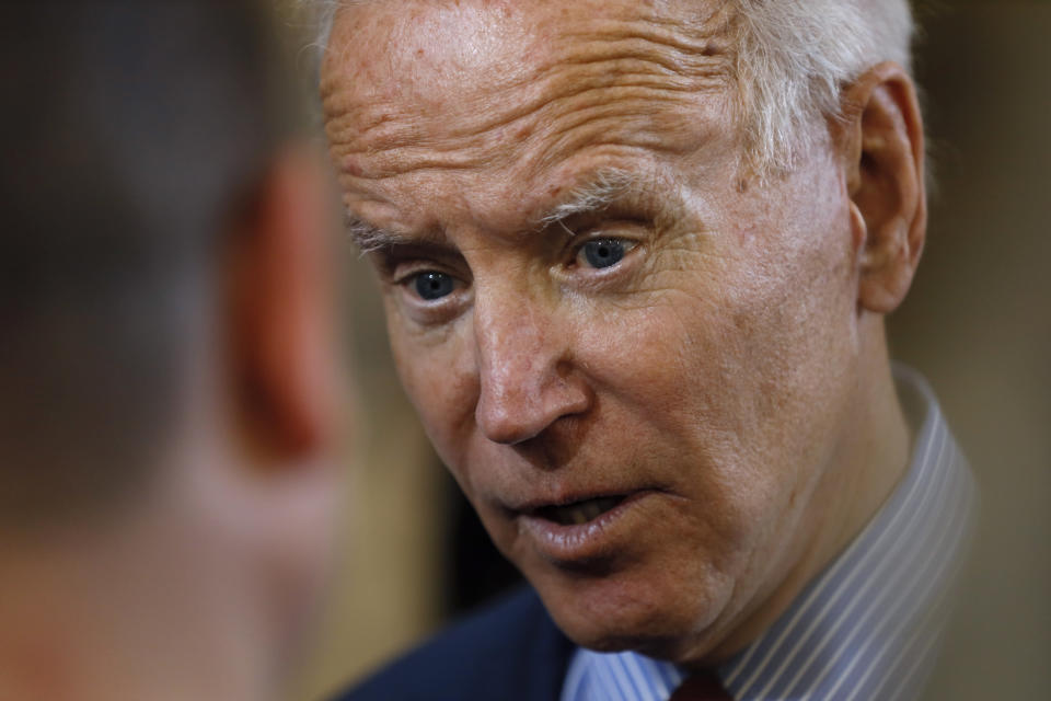Democratic presidential candidate former Vice President Joe Biden speaks with an audience member during a community event, Wednesday, Oct. 16, 2019, in Davenport, Iowa. (AP Photo/Charlie Neibergall)