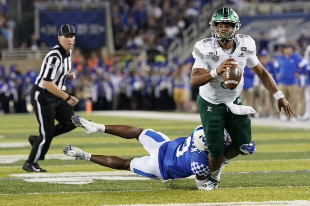 Eastern Michigan quarterback Mike Glass III (9) runs with the ball during the first half of an NCAA college football game against Kentucky, Saturday, Sept. 7, 2019, in Lexington, Ky. (AP Photo/Bryan Woolston)