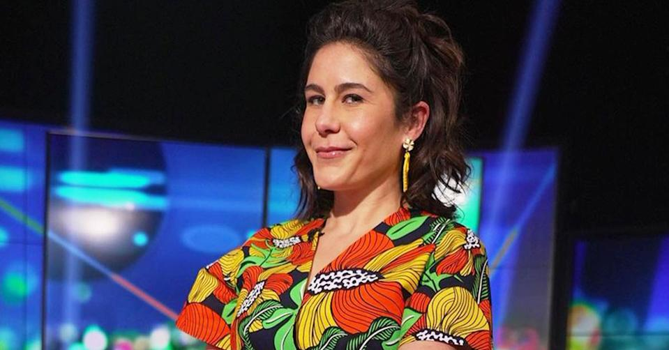 Jan Fran wearing a yellow and orange flower print jumpsuit on the set of The Project. Photo: Channel 10.