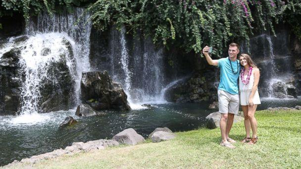 PHOTO: Josh and Michelle snap a selfie on their date in front of a waterfall in Maui. (Grand Wailea Resort)