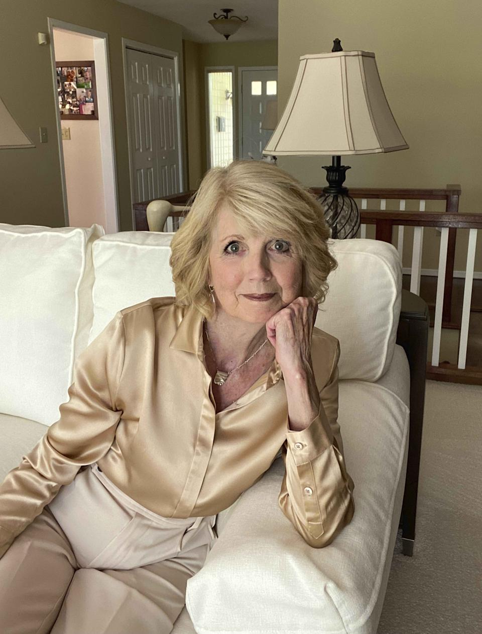 """This photo shows Candace Cima, 74, in Ithaca, New York, on Aug. 12, 2021. Cima, who goes by @styleinyour70s.withleslieb, is among a growing number of """"grandfluencers,"""" folks 70 and up who are making names for themselves on social media. (Gregory B. Rudgers via AP)."""