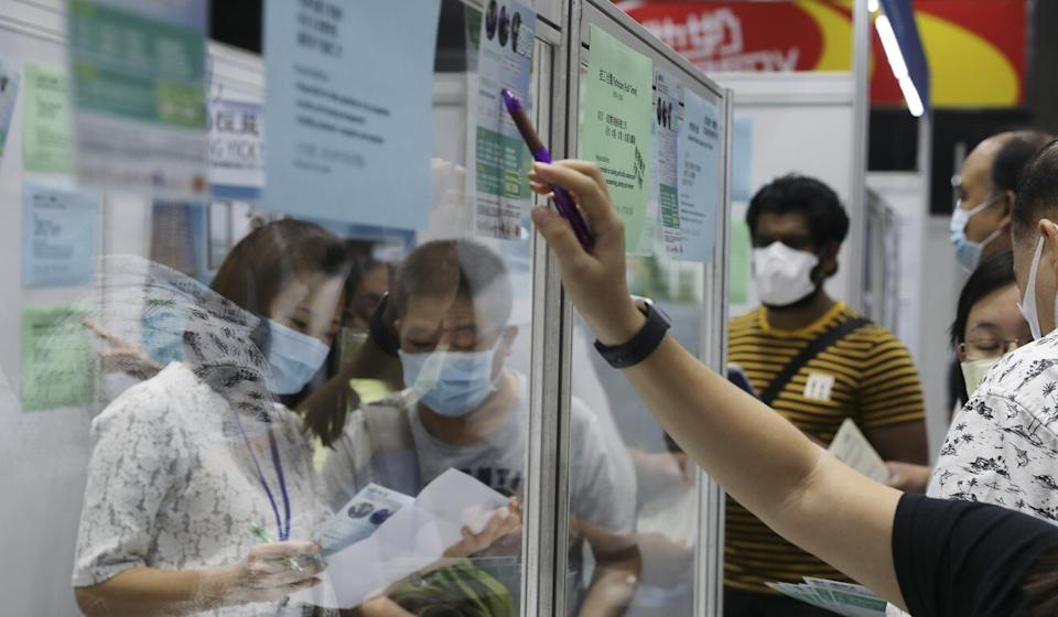 Jobseekers fill out application forms at a job fair held by Hong Kong's Labour Department in October. Photo: Nora Tam