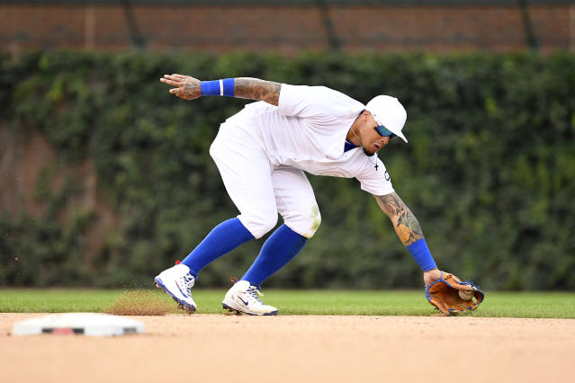 Chicago Cubs shortstop Javier Baez (9) fields the ball in the tenth inning against the Washington Nationals during an MLB Players' Weekend game at Wrigley Field. (Quinn Harris-USA TODAY Sports)