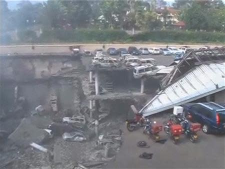 Debris and destroyed vehicles are seen at the collapsed Westgate shopping mall in Nairobi, in this still image taken from video shot September 25, 2013, provided by the Kenyan Defence Force, and released by Reuters TV on September 26, 2013. REUTERS/Kenyan Defence Force via Reuters TV