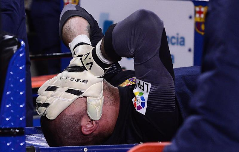 FC Barcelona's goalkeeper Victor Valdes reacts after being injured during a Spanish La Liga soccer match against Celta Vigo at the Camp Nou stadium in Barcelona, Spain, Wednesday, March 26, 2014