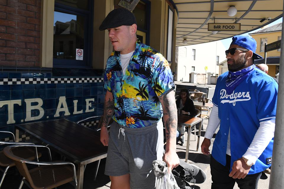 Former Canterbury Bankstown Bulldogs players David Klemmer (pictured left) and Tyrone Phillips (pictured right) arrive for Mad Monday celebrations in 2017. (AAP Image/Dean Lewins)