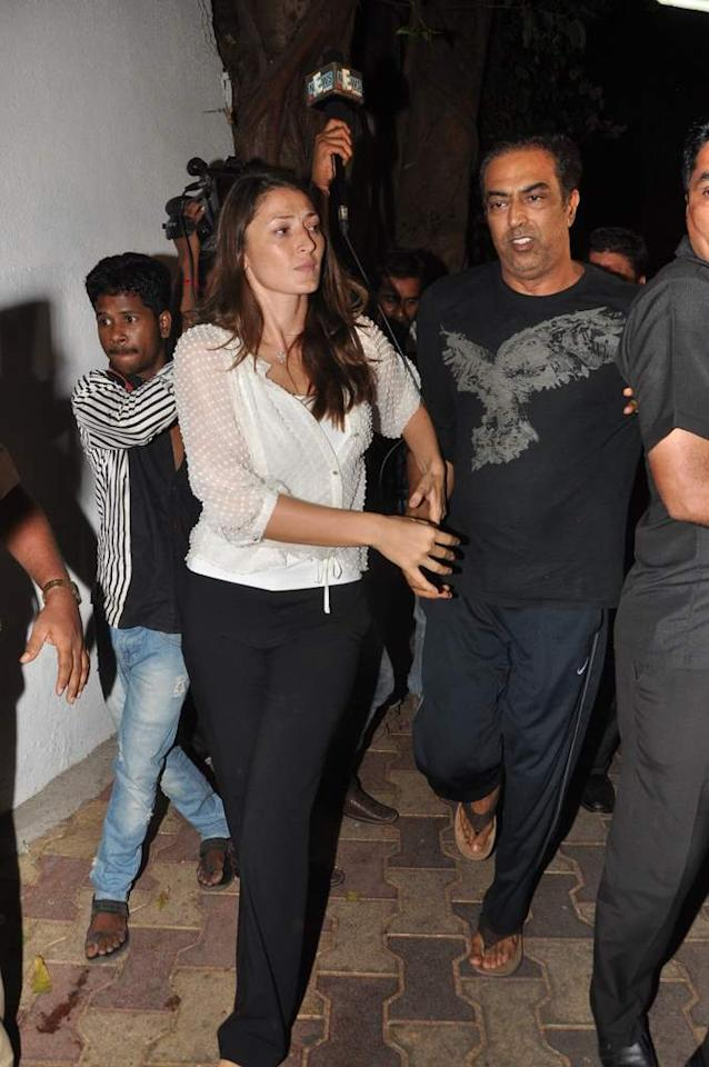Vindoo Dara Singh and his wife Dina Umarova leave after the small-time Bollywood actor addressed reporters after being released on bail. (Sanskrity Media)