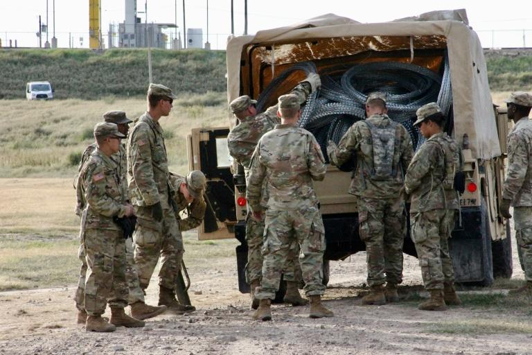 The Pentagon said it had approved a request from the Department of Homeland Security to keep thousands of troops deployed at the border with Mexico (soldiers pictured November 2018) to help fight illegal immigration