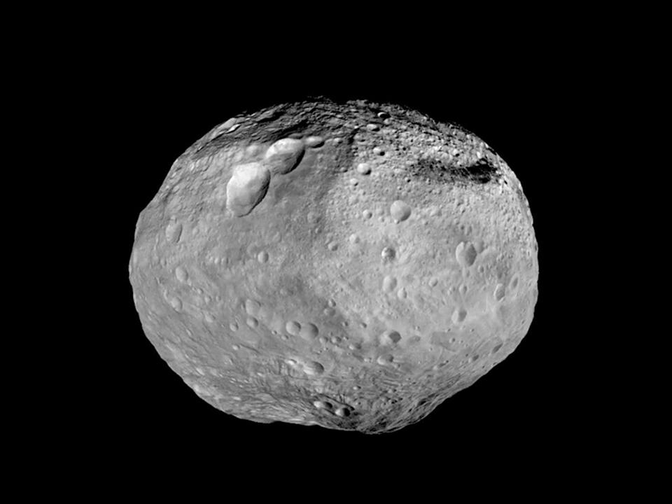<p>NASA's Dawn spacecraft circled Vesta between 2011 and 2012, collecting a treasure trove of information about the asteroid. </p><p>Dawn took pictures of the incredible features on the Vesta's surface including a mountain in the southern hemisphere that stretches higher than Mount Everest and a trio of impact craters that look like a snowman. </p>