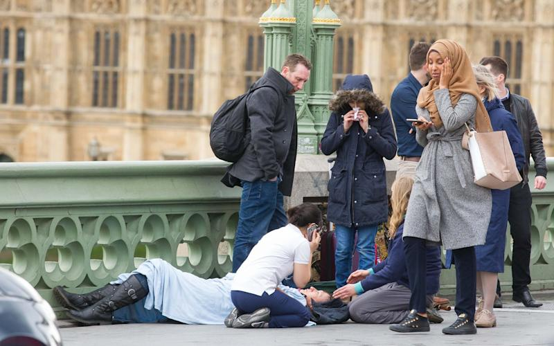 This image of a woman in a hijab at the scene of the terrorist incident on Westminster Bridge became a focus for anti-Islamic trolls - Jamie Lorriman