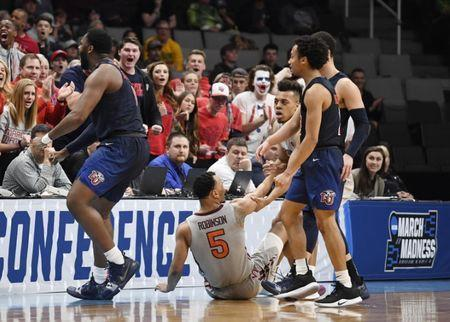 Mar 24, 2019; San Jose, CA, USA; Liberty Flames forward Myo Baxter-Bell (0) reacts after drawing a charge against Virginia Tech Hokies guard Justin Robinson (5) during the first half in the second round of the 2019 NCAA Tournament at SAP Center. Mandatory Credit: Kelley L Cox-USA TODAY Sports
