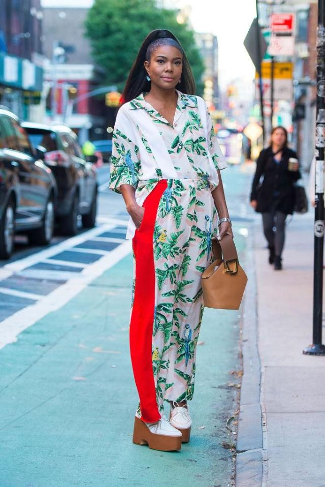 <p>Gabrielle Union pairs the Danse Lente brown leather bucket bag with her tropical-themed PJ set while out in New York City. (Photo: Gotham/GC Images) </p>
