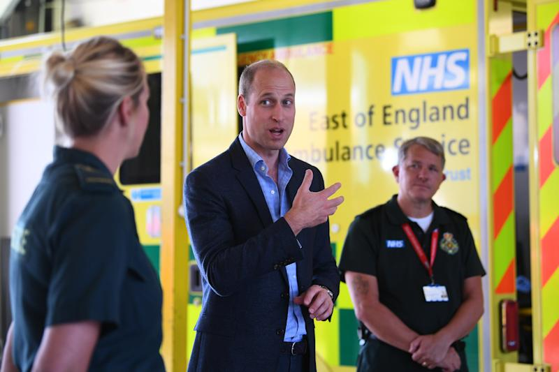 The Duke of Cambridge talking to paramedics from the East of England Ambulance Service Trust during a visit to the Ambulance Station in King's Lynn, Norfolk.