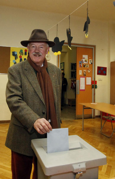 General chief of staff of the Austrian army Edmund Entacher casts his vote for an army referendum at a polling station in Vienna, Austria, Sunday, Jan. 20, 2013. At issue in this neutral nation of just over 8 million people is whether to keep the present system that relies heavily on conscripts or to go with the European flow and create a professional army, as have 21 of the EU's 26 other members. The present model consists of about 35,000 troops, with about 14,000 professionals and the rest conscripts who serve for six months as well as a 30,000-strong part-time militia. (AP Photo/dapd, Ronald Zak)