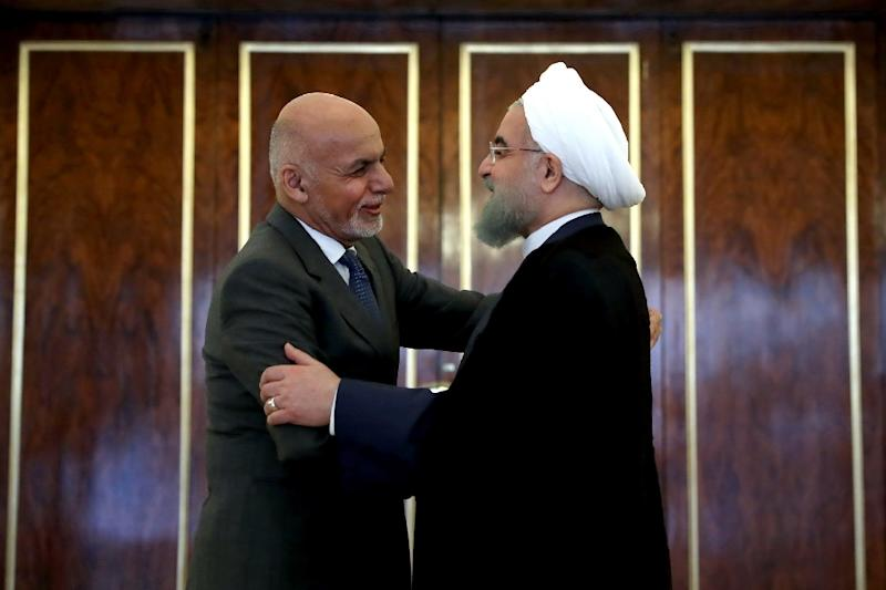 Iranian President Hassan Rouhani embraces his Afghan counterpart Ashraf Ghani during his August 2017 visit to Tehran