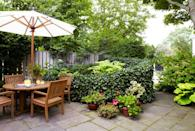 """<p>By obscuring parts of the yard, a curved ivy fence can visually enlarge it. """"You can't see the entire garden from any one vantage. You're unsure where it ends, so it seems bigger than it is,"""" says landscape designer <a href=""""http://www.louistheplantgeek.com/goodhousekeeping-secrets-of-a-small-garden"""" rel=""""nofollow noopener"""" target=""""_blank"""" data-ylk=""""slk:Louis Raymond"""" class=""""link rapid-noclick-resp"""">Louis Raymond</a>. </p>"""