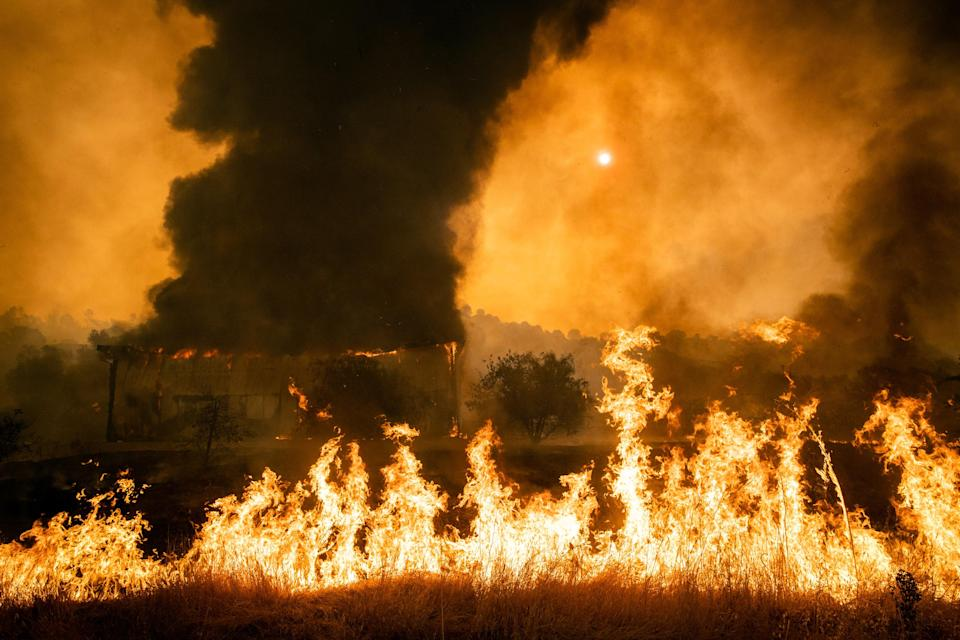 A structure burns in Vacaville, Calif., on Wednesday, Aug. 19, 2020. (Max Whittaker/The New York Times)